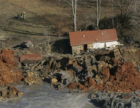 sludge-retention-wall-collapsed