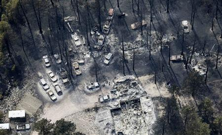 An aerial view of a destroyed house and vehicles in the aftermath of the Black Forest Fire in Black Forest, Colorado