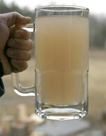 A glass of water taken from  a residential well after the start of natural gas drilling in Dimock, Pennsylvania