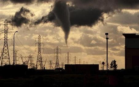 A tornado funnel approaches a residential area on the west side of Roseville